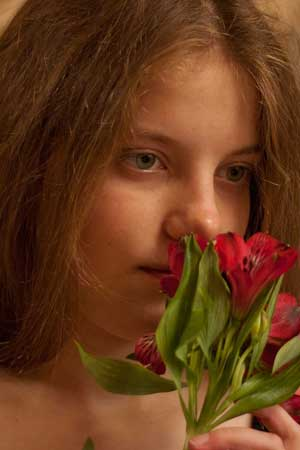 Girl smeling a flower