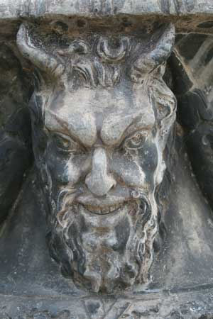 Stone carving of demon